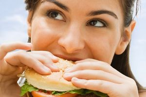 Teenage+girl+eating+a+hamburger.jpg